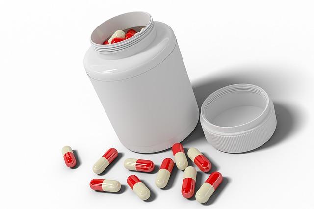 červenobílé tabletky, bílá lahvička
